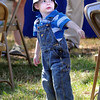 Garden gawk: Two-year-old Leis Speer of Terre Haute watches activities at the  Community Garden Party Saturday morning. He's attending with his mother Karla Speer.