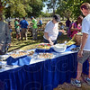 Garden party: Party goers enjoy the veggies being served Saturday morning at 11th and Chestnut at the Community Garden Party.