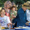 Garden grub: Community Garden Party goers fill their plates with garden grub during Saturday morning's event.