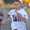 Tribune-Star/Joseph C. Garza<br /> Fast finish: Cory Ray, 13, of Indianapolis sprints to the finish line of the Run for the Fallen Saturday on Brown Avenue near Wabash Avenue. Cory's grandparents are Paul and Sherry Ray of Terre Haute.