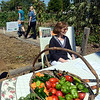 Walk: Garden Party goers walk through the Community Garden at 11th and Chestnut Streets Saturday morning.