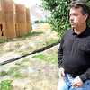 Tribune-Star/Jim Avelis<br /> Too close: Mike Poinsett stands on the easement behind his Woodgate home looking out over the construction site of Cobblestone Crossing.