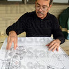 Tribune-Star/Jim Avelis<br /> R-3: Woodgate resident Mike Poinsett points to the area of most recent construction of multi-family units in Cobblestone Crossing. His property lies just 25 feet from the back of the apartments being built.