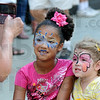 Picture: Peggy Deckard photographs eight-year-old Jaylee Shelby and three-year-old Hayley Richard as they sit in the shade along Wabash Avenue during the Block Party.