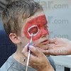 Eye Q : Four-year-old  Abraham Drake gets his face painted at the Block Party Saturday afternoon.