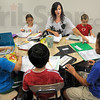 Elementary: Rebecca Boehler works with her class Friday morning at DeVaney Elementary School.