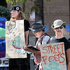 Poetry: The Street Poets perform Satuday afternoon at 7th Street and Wabash Avenue during the annual Block Party.
