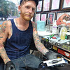 "Tribune-Star/Jim Avelis<br /> Customer protection: Chris Johnson, tattoo artist at Eternal Ink, shows the sterile packaging his needles and grips come in. Johnson has seen many ""home done"" tattoos come into his booth, some poorly done, some badly infected, some both."