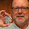"Tribune-Star/Jim Avelis<br /> Thinking: Clabber Girl's Gary Morris holds a button promoting the book ""Food for Thought an Indiana Harvest"". Morris is one of more than 80 Hoosiers interviewed and photographed for the David Hoppe book."