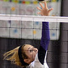 Tribune-Star/Jim Avelis<br /> Tip: Clay City's Alyssa Yocum gets a point off a tip in the Eels match with Bloomfield.
