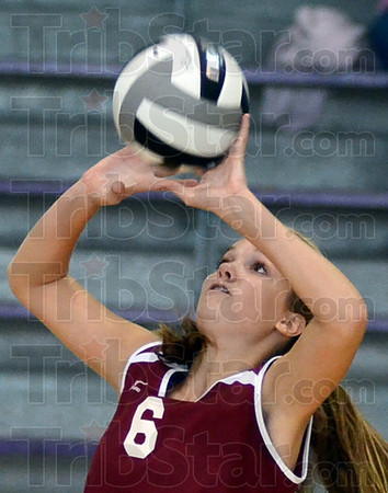 Tribune-Star/Jim Avelis<br /> Setting it up: Bloomfield outside hitter Emily Bucher sets for a team mate in the Cardinal's loss to host Clay City Saturday morning.