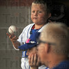 Blues: Rex bat boy Nick Winning juggles a ball and watches as a Hannibal runner scores during first inning action Saturday evening at Bob Warn Field.
