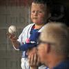 Blues: Rex bat boy Nick Winning juggles a ball and watches as a Hannibal runner scores during first inning action Saturday evening at Bob Warn Field.