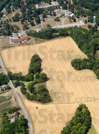 Tribune-Star/Joseph C. Garza<br /> Slow roasted: Crop land near St. Mary-of-the-Woods College reflects the dry hot weather during a flight Wednesday.