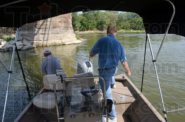Search: Brendan Kearns (L) and Tribune-Star reporter Arthur Foulkes use underwater video and still cameras attempting to find the locomotives that fell from the bridge over the Wabash River many years ago.