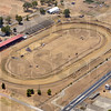 Tribune-Star/Joseph C. Garza<br /> Putting the dirt in dirt track: Bleached by a relentless sun and no rain fall, the dead grass of the infield of The Terre Haute Action matches the dirt of the oval track itself.