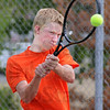 Contact: South's number one singles player Nathan Bogle returns a shot during Monday's practice at the school.