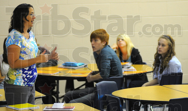 Tribune-Star/Jim Avelis<br /> Be careful: Riverton-Parke's Jill Wiram talks with juniors about the care of their new laptop computers.