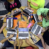 Tribune-Star/Jim Avelis<br /> Fired up: A table full of Riverton-Parke juniors log on to their new laptop computers Wednesday afternoon.