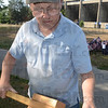 Tribune-Star/Jim Avelis<br /> Inventive: Jim Fuelle displays one of the many different devices used to make pilot holes for the flags at Memorial Stadium Wednesday evening. Drills with long bits and hammers with screwdrivers were also in evidence.
