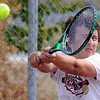 Eye on the ball: Josh Gayso hits a backhand during Monday's practice at Terre Haute South.