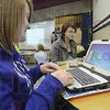 Tribune-Star/Jim Avelis<br /> Logging on: Riverton-Parke juniors Catie Butler and Browdie Boillard fire up their new laptop computers Wednesday morning. Paid for through textbook fees, the PC based computers can be used in a tablet format.