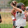 Tribune-Star/Joseph C. Garza<br /> Long range: Terre Haute South quarterback Danny Etling spots an open wide receiver down the practice field during the Braves' first day of practice Monday at South.