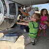 "Tribune-Star/Joseph C. Garza<br /> Just about his size: Solomon Mervis, 7, of Carmel gets a closer look into the ball turret underneath the B-17 Flying Fortress ""Nine O Nine"" as former turret operator Harold Plunkett describes how it works Wednesday at the Terre Haute International Airport."
