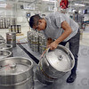 Tribune-Star/Joseph C. Garza<br /> Clean kegs: Victor Segoviano cleans a group of kegs at the Upland Brewery in Bloomington Wednesday.