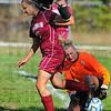Tribune-Star/Jim Avelis<br /> Stopped: Northview's Haley Zadeii has the ball taken away by West Vigo goal keeper Alexa Clingerman