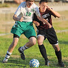 Tribune-Star/Jim Avelis<br /> All in: West Vigo defender Clayton Minger(12) and Northview forward Antoney Bryan fight for the ball in first half action Wednesday night.