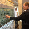 "Tribune-Star/Jim Avelis<br /> In touch: Indiana State University foundation President Ron Carpenter tries the new touch screen monitors in the foyer, or ""Living Room"" of the new John W. Moore Welcome Center on the ISU campus."