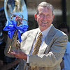 Tribune-Star/Jim Avelis<br /> Key to progress: Indiana State University President Emeritus John W. Moore holds the prop key he used to ceremonially open the ISU welcome center named in his honor.