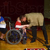 Tribune-Star/Joseph C. Garza<br /> Way to go, kid: Eastern Greene Elementary fourth-grader BJ Yoho receives a hug from Ty Mungle, the Eastern Greene Schools superintendent, during Yoho's presentation as the 2012 Children's Miracle Network Hospitals Champion for Indiana Wednesday near Bloomfield.