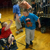 """Tribune-Star/Joseph C. Garza<br /> Five for """"BJ Claus"""": Eastern Greene Elementary fourth-grader BJ Yoho receives a high-five from a classmate after his presentation as the 2012 Children's Miracle Network Hospitals Champion for Indiana Wednesday near Bloomfield."""