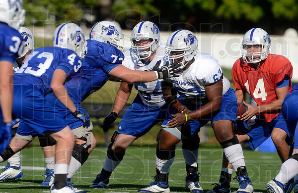 Tribune-Star/Joseph C. Garza<br /> On the line: Offensive lineman Adam Masters (64) prepares to clash with the defensive line with teammate Clyde Ignont (63) during team practice Tuesday at Memorial Stadium.