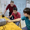 Tribune-Star/Joseph C. Garza<br /> Mars experience: Rose-Hulman Institute of Technology Professor Rick Ditteon watches as freshmen Josh Bertsche, 19, of West Chicago, Ill., and Dan Hanson, 18, of Spring Lake, Michigan, work on a project for their resonance in strings lab Wednesday at Rose-Hulman. Ditteon worked as a young scientist on the NASA Viking probes that landed on Mars in 1976.