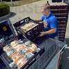 Bun buster: Billy Bettis of Aunt Millie's Bakery unloads a truck load of buns for delivery at Davis Park Elementary school Monday afternoon in preparation for the first day of school Tuesday.