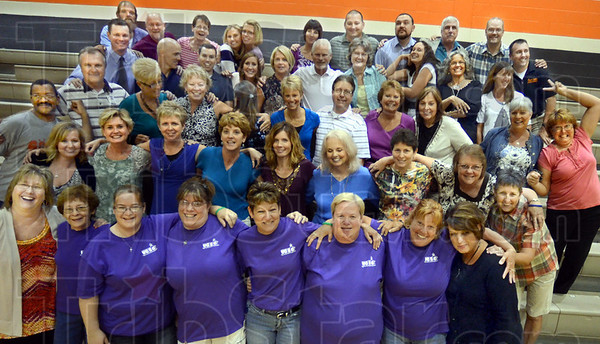 "We are family: The Sarah Scott faculty and staff pose for a ""family"" photograph in the school gym Monday afternoon."