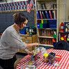 Preparations: Farrington Grove teacher Kristen Malloy prepares her classroom for the start of the school year Monday afternoon. Classes begin Tuesday morning.