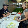 Tribune-Star/Jim Avelis<br /> Personal contact: Jordan Borders chats with Robin Vibbert of Spencer at the Ciao Itaia exhibit in the Indiana State Fair Friday afternoon. Borders is a Jasonville native and Indiana State University senior who coordinated the exhibit at the fair.