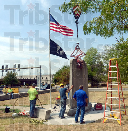 Grip: A crane supports the Vietnam Memorial on the grounds of the Vigo County Courthouse as a crew removes it from its base for relocation to the 3rd Street side of the building.