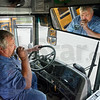 10-4: Vigo County School Corporation mechanic David Atkinson calls the dispatcher for a radio check as he does a final inspection of busses to make sure they are ready for Tuesday's first day of school.