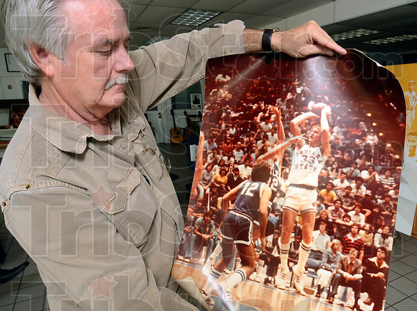 Tribune-Star/Joseph C. Garza<br /> From image to bronze: Artist Bill Wolfe displays the photo he is working off of for the Larry Bird statue at his studio on Ohio Street.