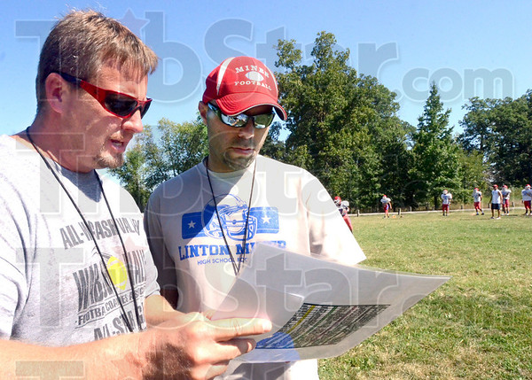 Coaches: Linton head coach Steve Weber (L) and his assistant Brian Oliver confer during Monday's practice session at the school.