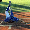 In there: Kyle Zimmerman slides around the Danville catcher and scores during action Monday evening at Bob Warn Field.