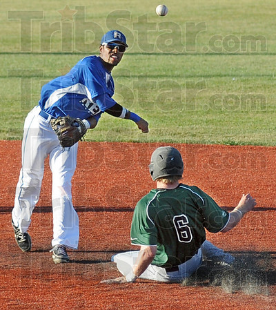 Turn two: Rex second baseman Edmund Cheatham fires to first base for a double play after forcing a Danville base runner during Monday's game.