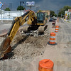 Tribune-Star/Joseph C. Garza<br /> First cut: An excavator sits near the intersection of Wabash Avenue and 13 and 1/2 Street Tuesday afternoon after work crews made the first dig into the street to remove the remnants of the city's old rail system.