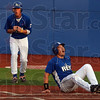 Say it isn't so, blue!: Terre Haute's Michael Schroeder, bottom right, and teammate Nick Johnson react to the home plate umpire's call of out during the Rex' game against Danville Tuesday at Bob Warn Field at Sycamore Stadium.