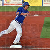 Full speed: Patrick Chandler turns on the speed as he rounds third base to score the team's second run of the night during the Rex' game against Danville Tuesday at Bob Warn Field at Sycamore Stadium.
